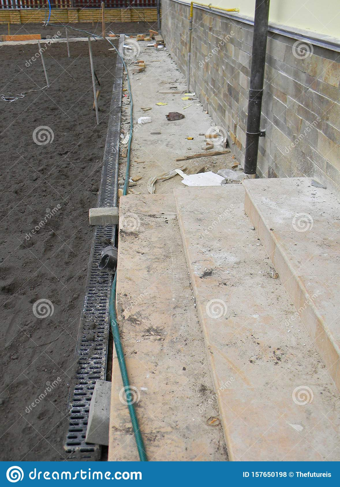 Concrete Pathway Under Construction With Rainwater Drainage System For House Foundation Wall Waterproofing Protection Stock Photo Image Of Downspout Incomplete 157650198
