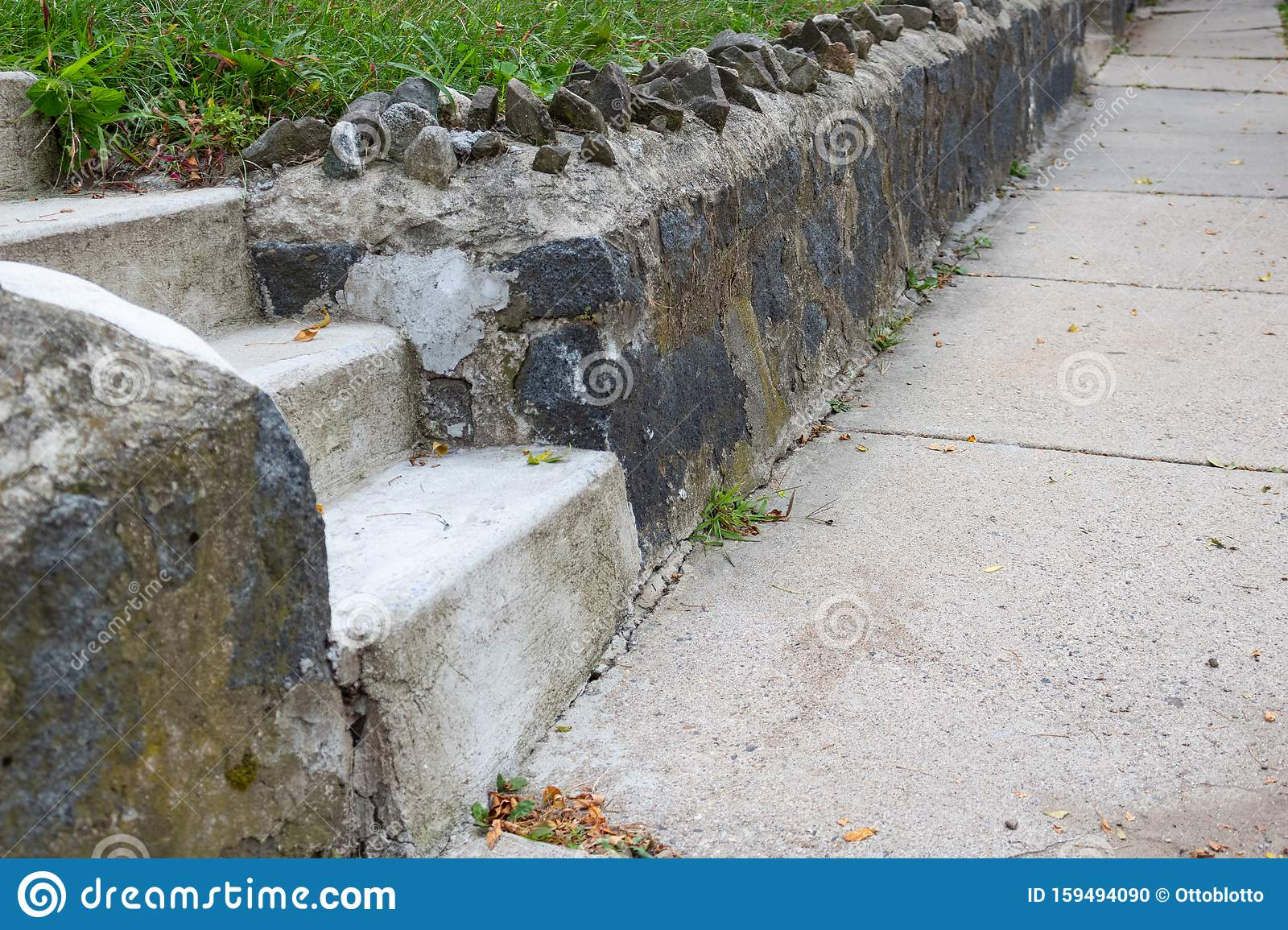 Concrete Sidewalk Beside A Rock Retaining Wall Cement Stair Stock