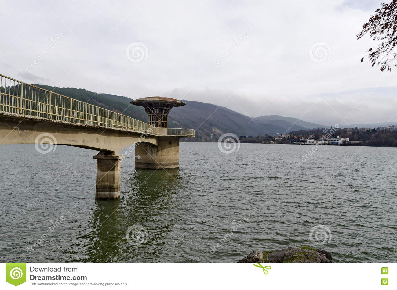 Concrete tower - equipment of picturesque dam, gather water of Iskar river