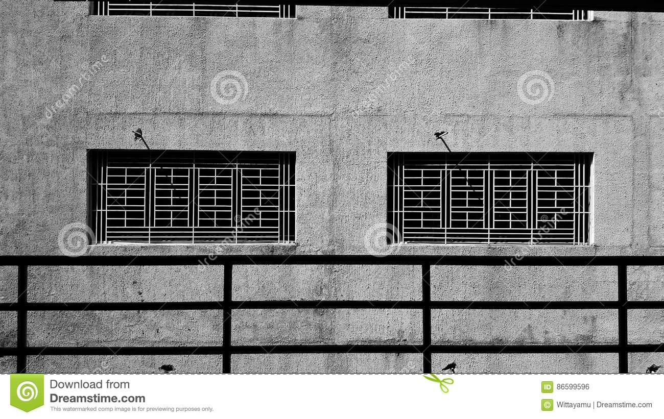 The Concrete Wall And Steel Frame Window Stock Photo - Image
