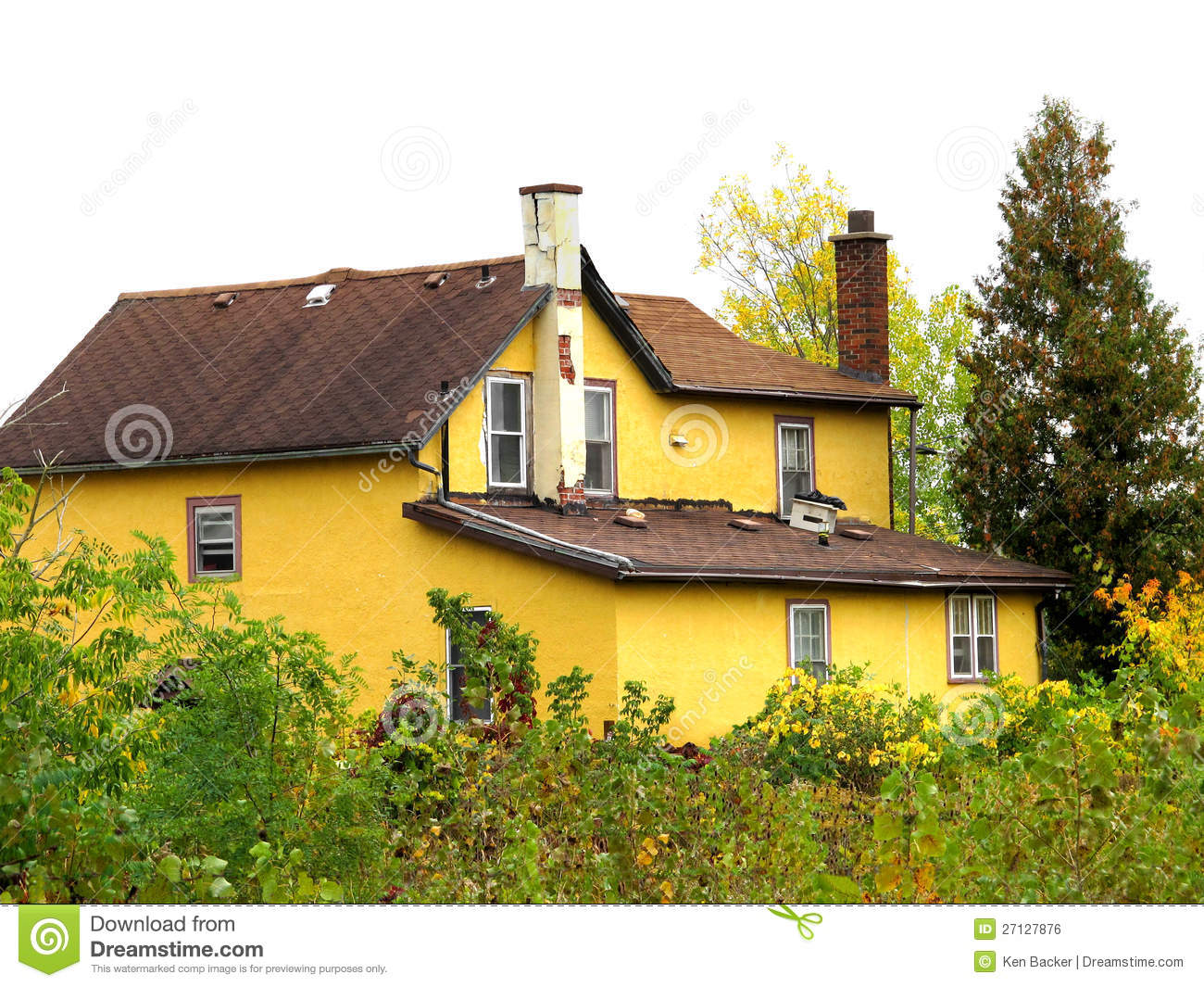 condemned and abandoned yellow city house royalty free