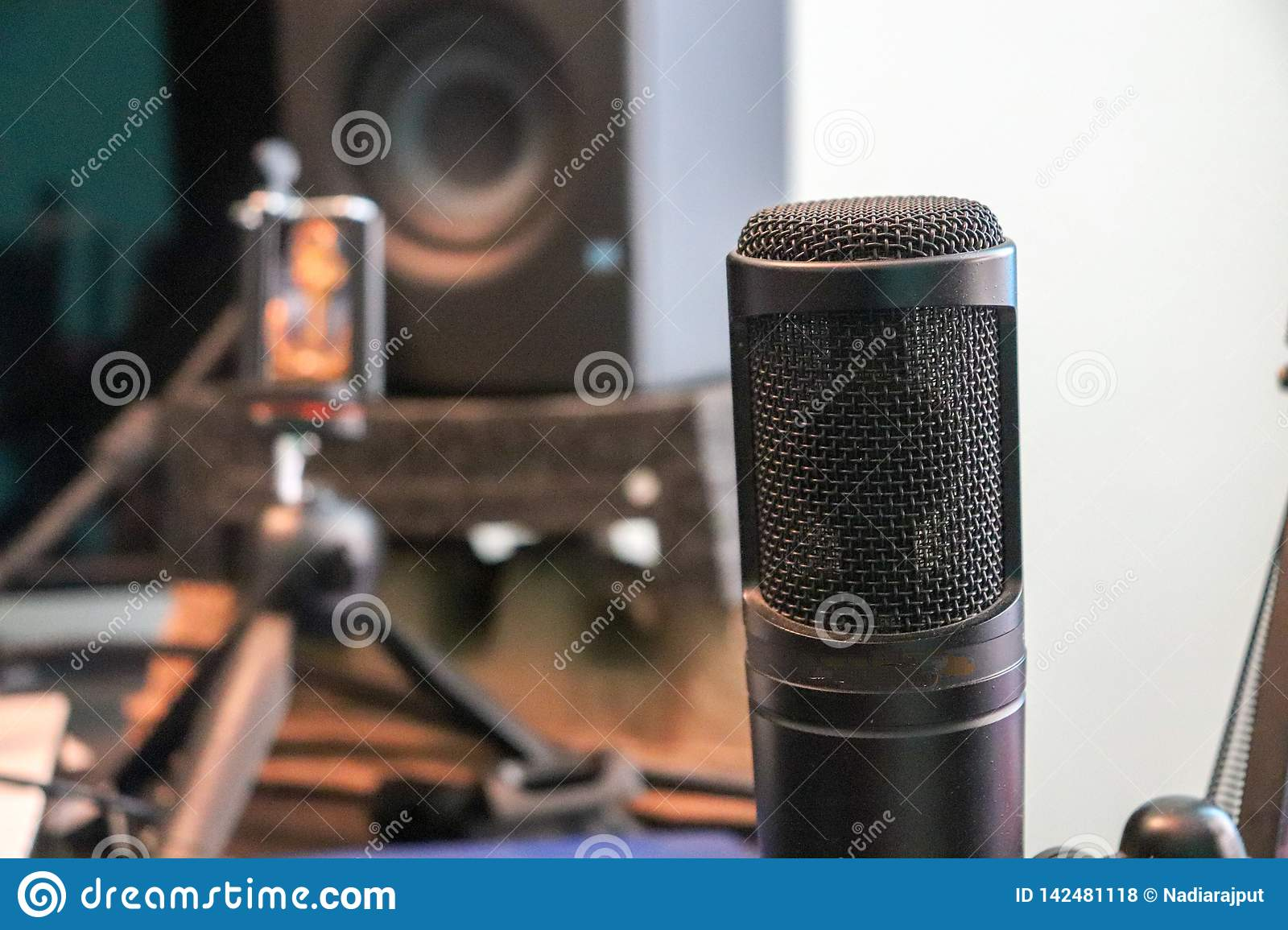Condenser microphone in a recording studio