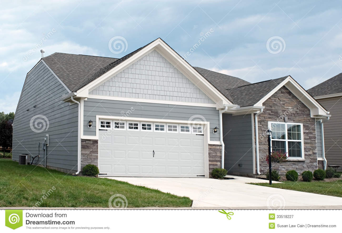 Small gray house with garage royalty free stock image for Two car garage doors