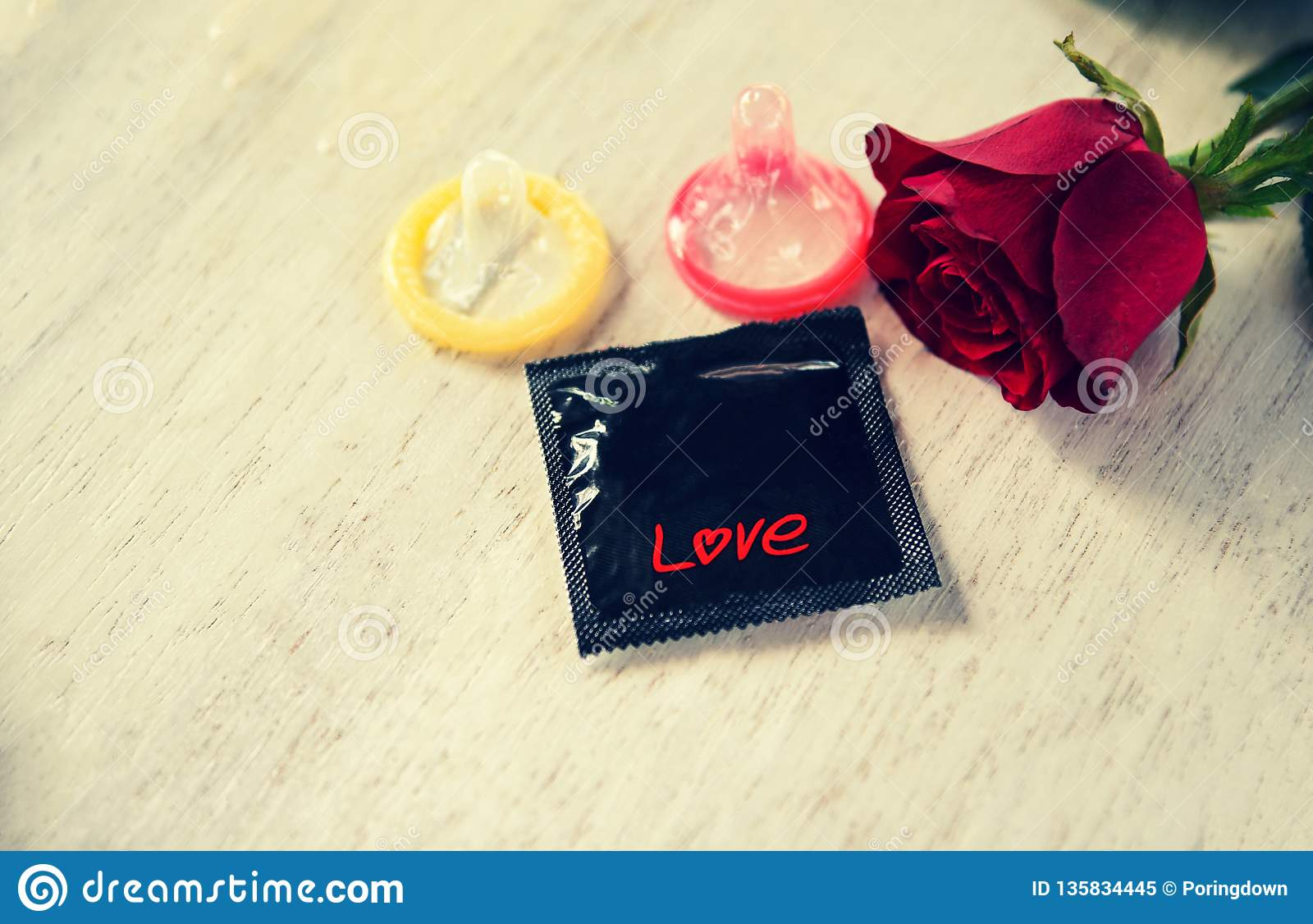 Condom Prevent Pregnancy Contraception Valentines safe sex concept pregnancy or sexually transmitted disease