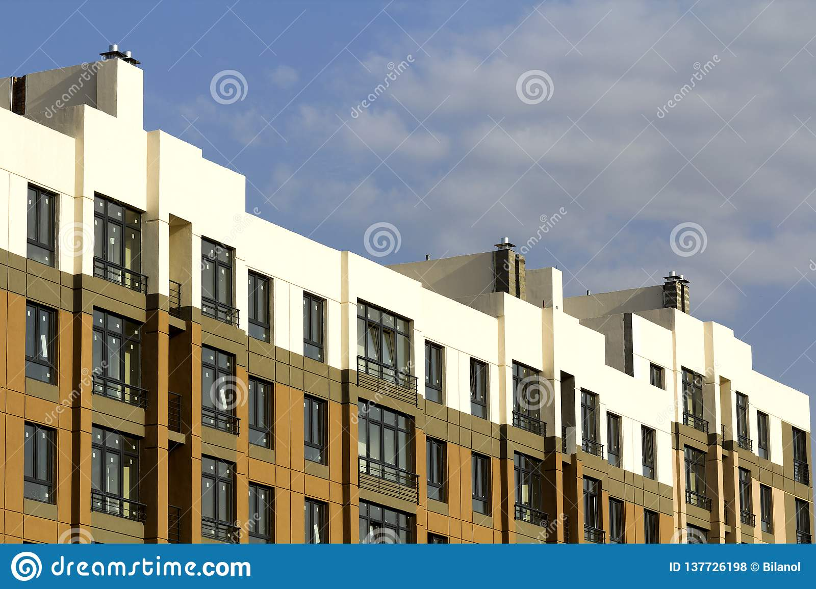 Condominium or modern apartment building with symmetrical architecture in the city downtown. Real estate development and urban
