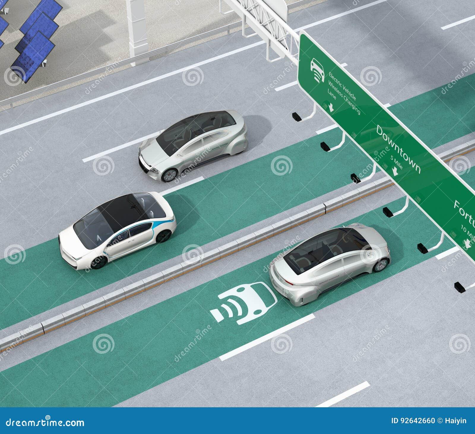 Condução de carros bondes na pista de carregamento sem fio da estrada