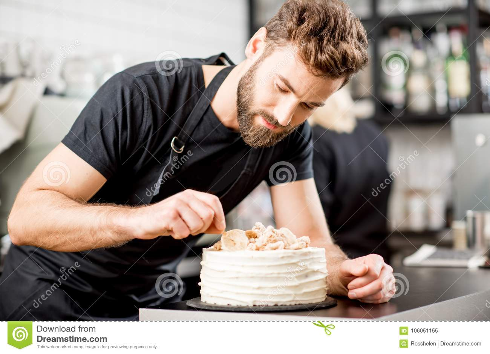 Confectioner decorating a pie
