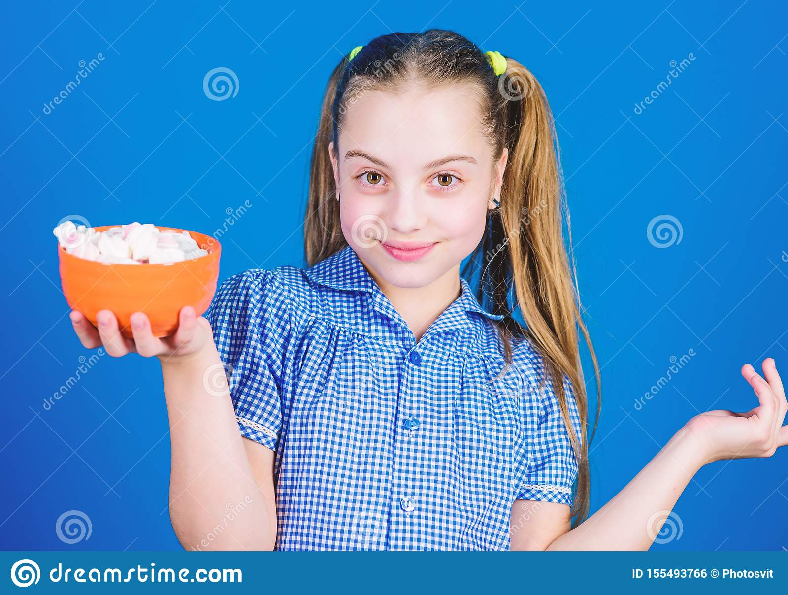 Confectionery. happy little child love sweets and treats. Small girl eat marshmallow. marshmallow. Candy shop. Healthy