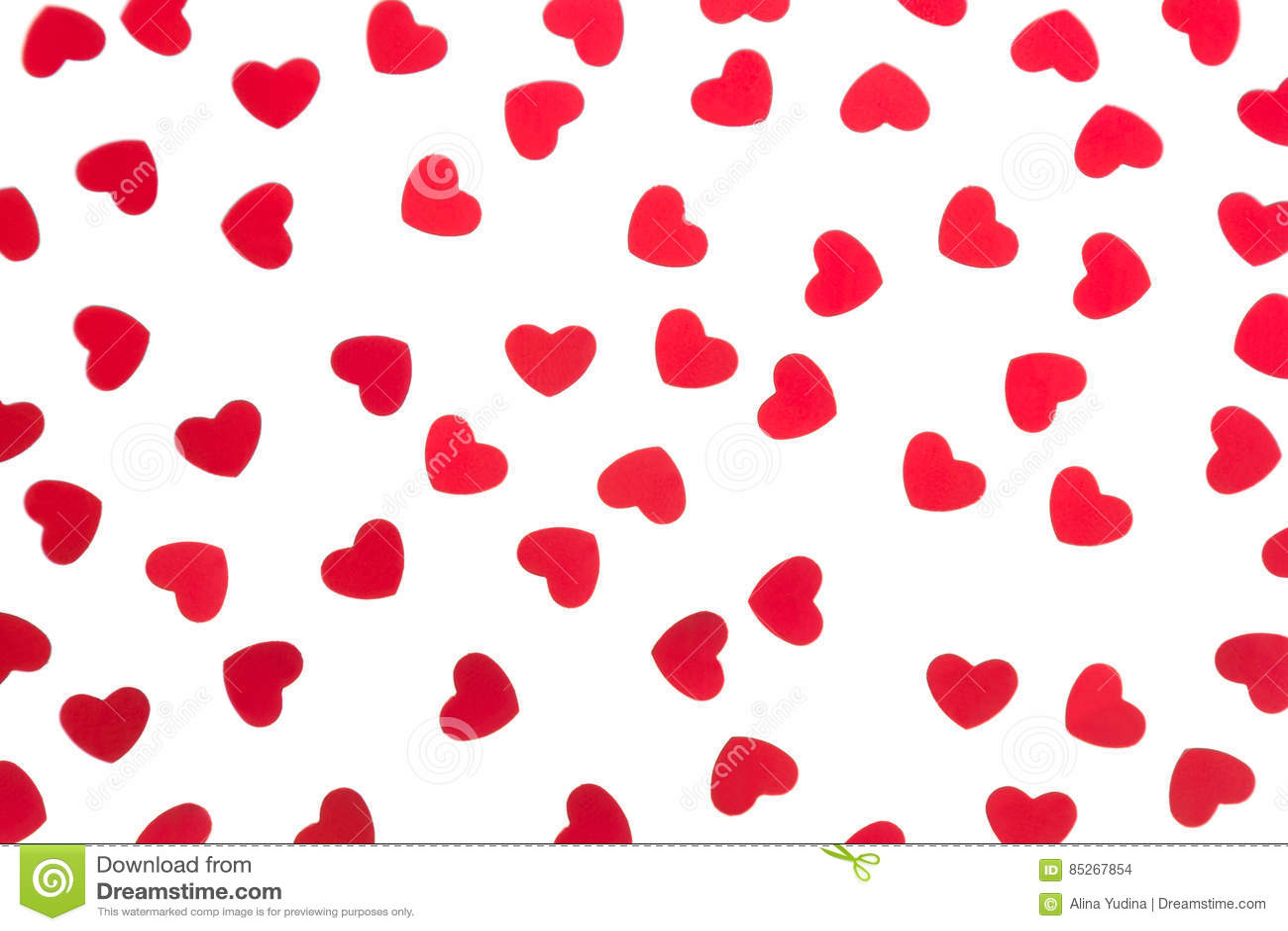 Confeti rojo de los corazones del modelo decorativo del día del ` s de la tarjeta del día de San Valentín aislado en el fondo bla