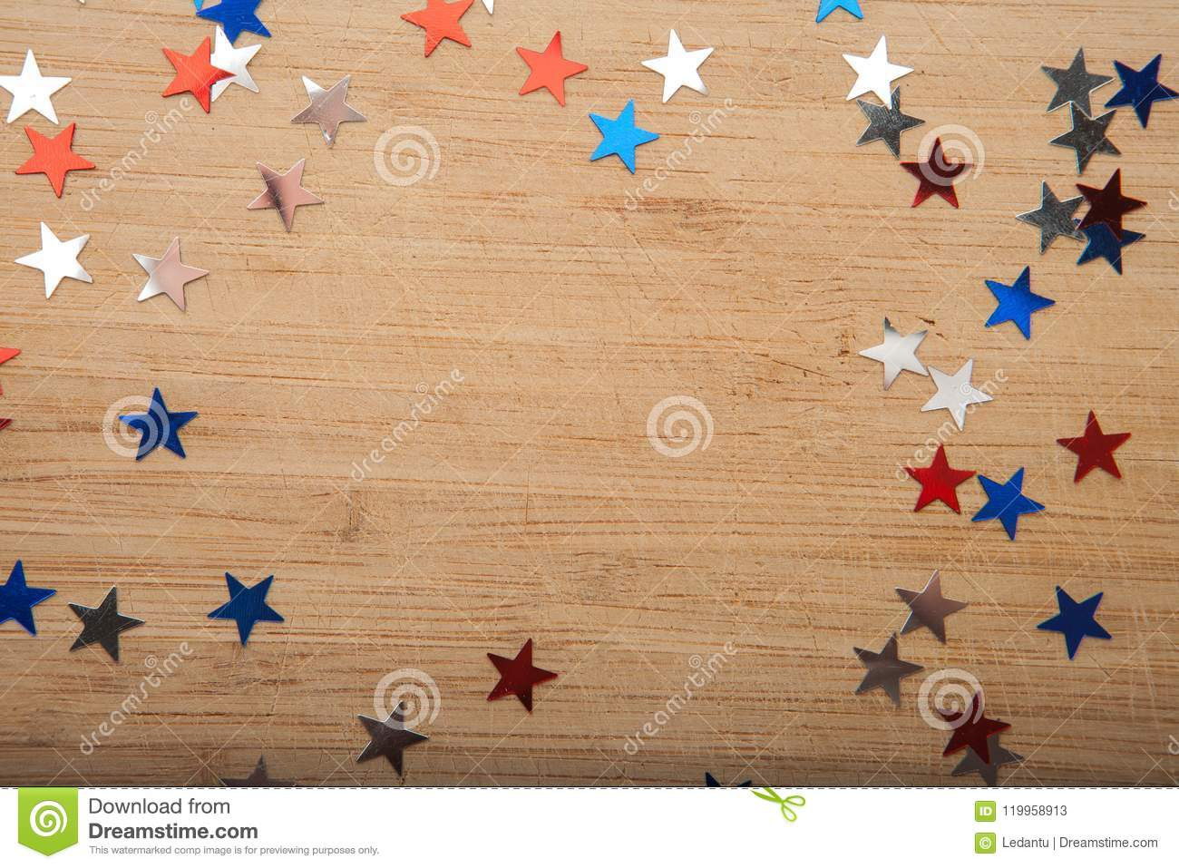 confetti stars on wooden background 4th july independence day