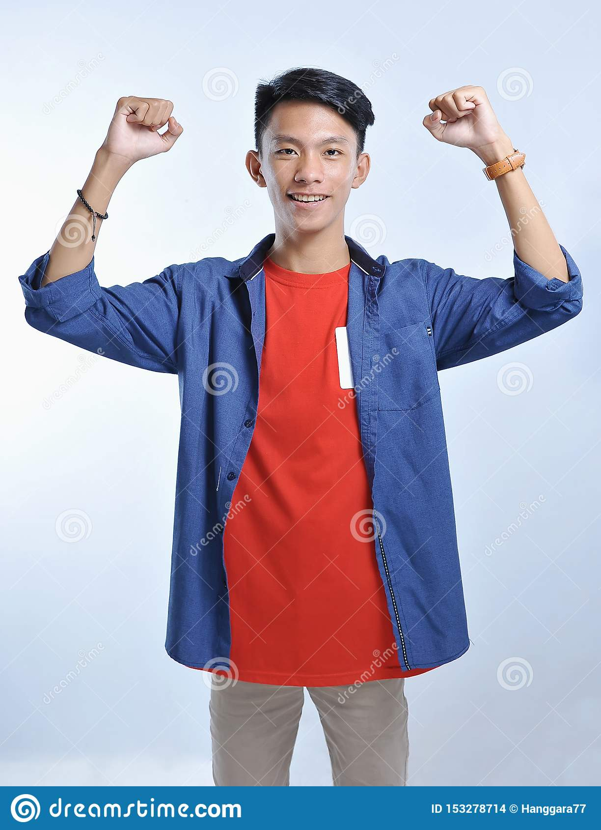 Confidence Asian young man wear casual t-shirts with confident smiling