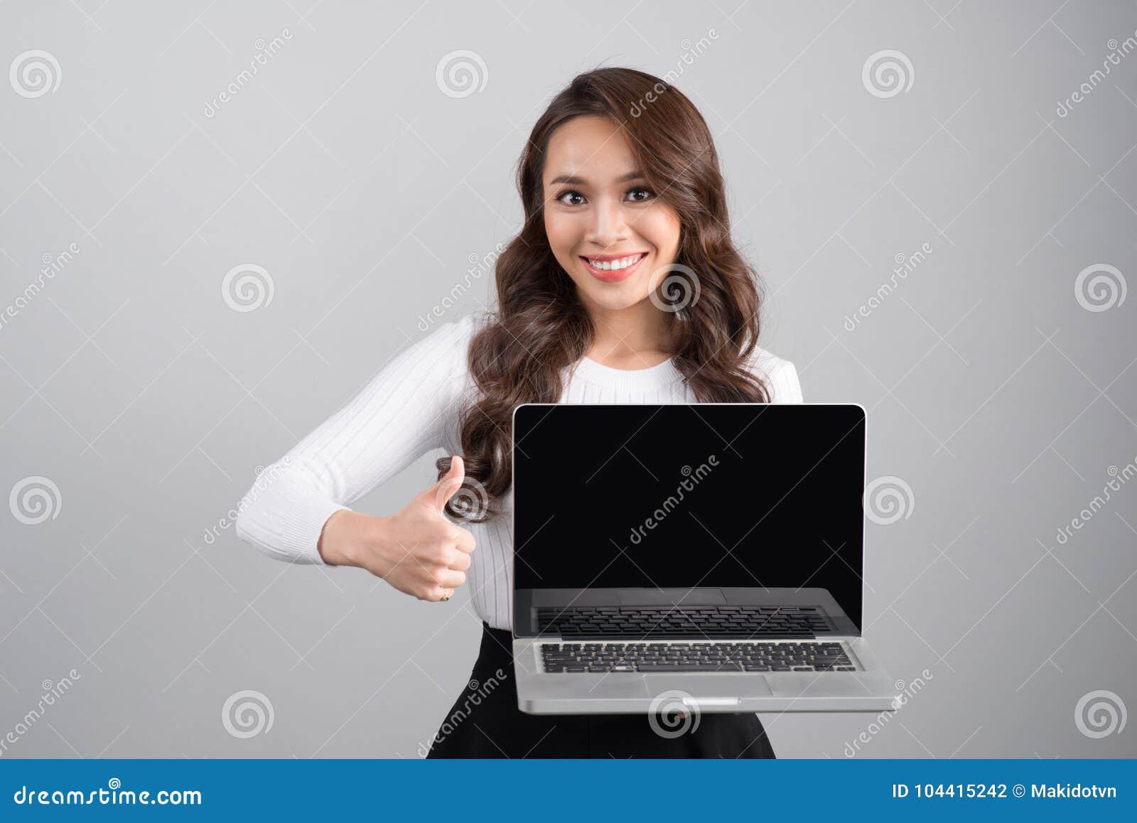 Confident asian business woman showing laptop screen.