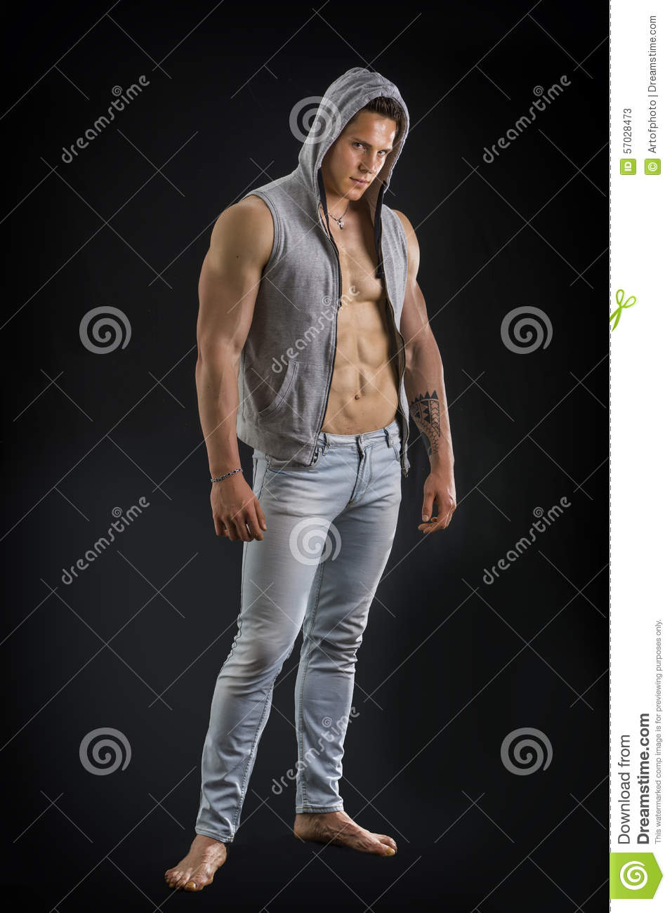 Attractive Young Man With Open Jacket On Muscular Torso