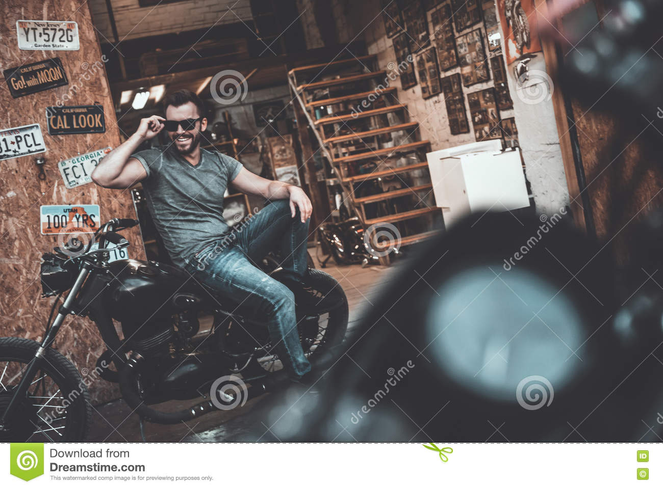 Confident biker. stock image. image of macho garage 78740339