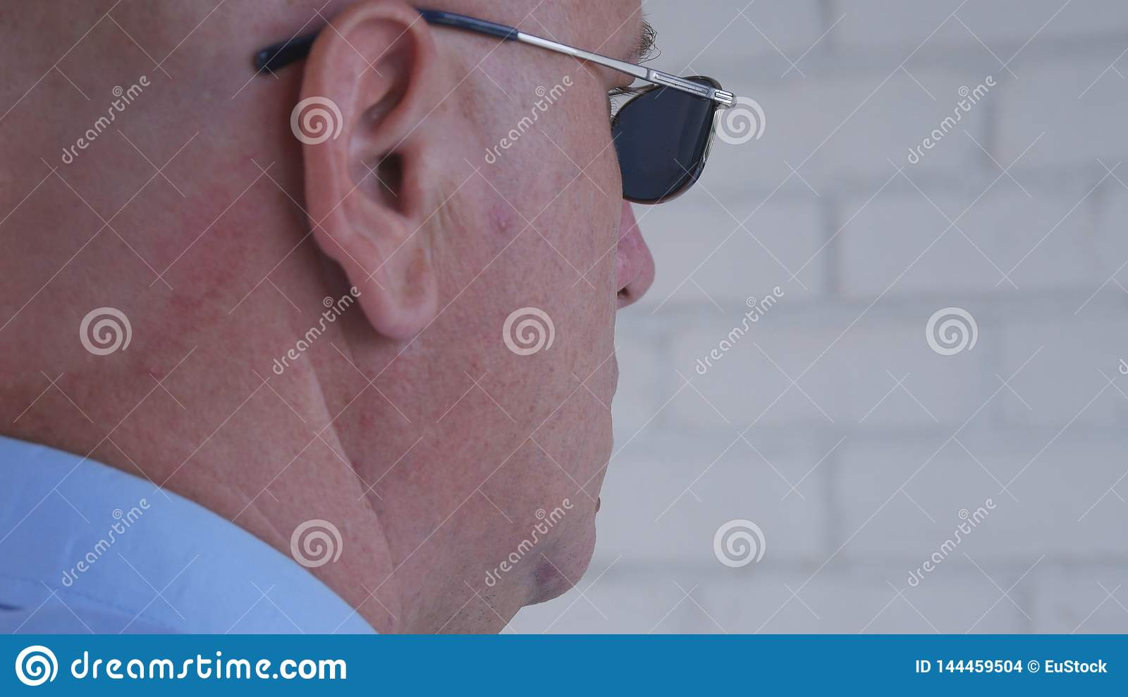 Confident Bodyguard Image Wearing Black Sunglasses Doing a Security Job