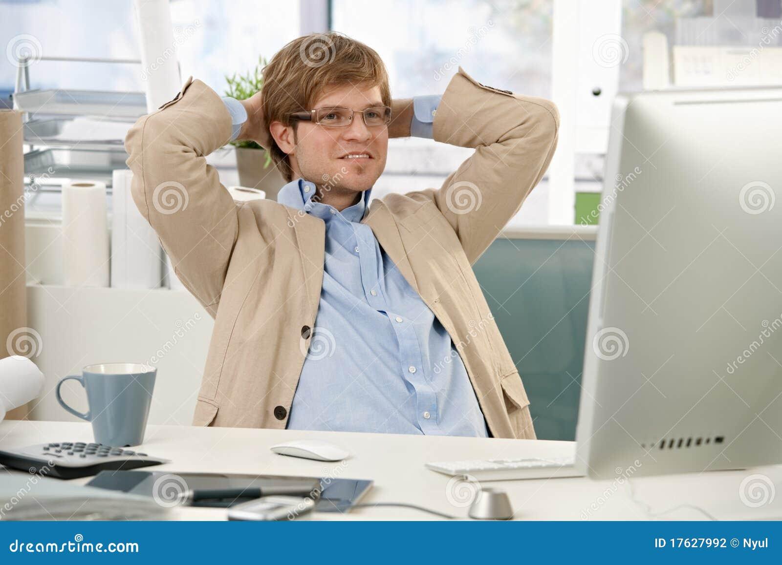 Confident businessman at desk desk