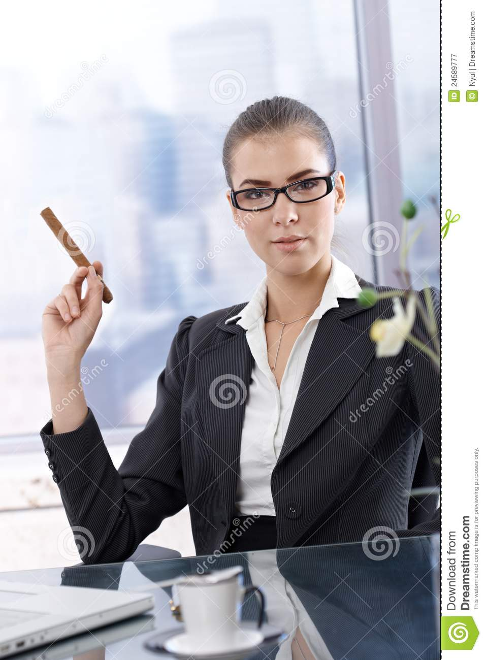 confident businesswoman with cigar royalty free stock