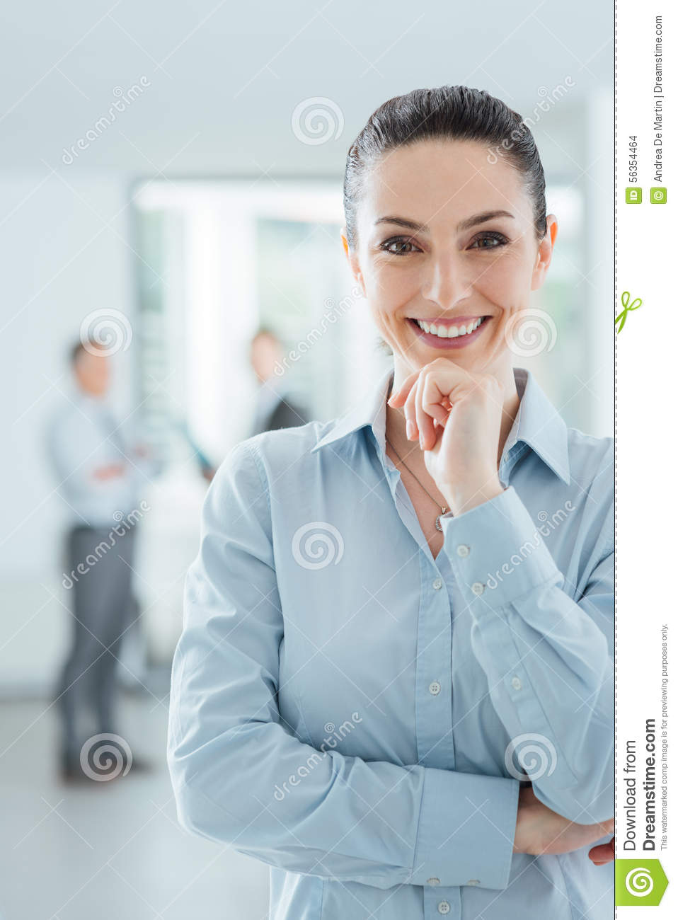 Confident Businesswoman In The Office Posing Stock Photo