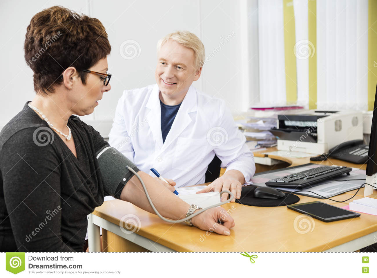 Confident Doctor Checking Female Patient s Blood Pressure