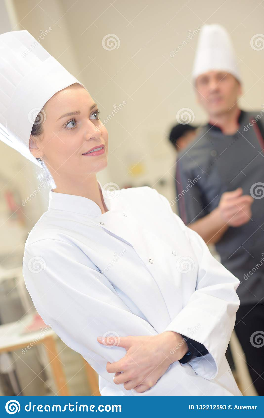Confident female chef in commercial kitchen