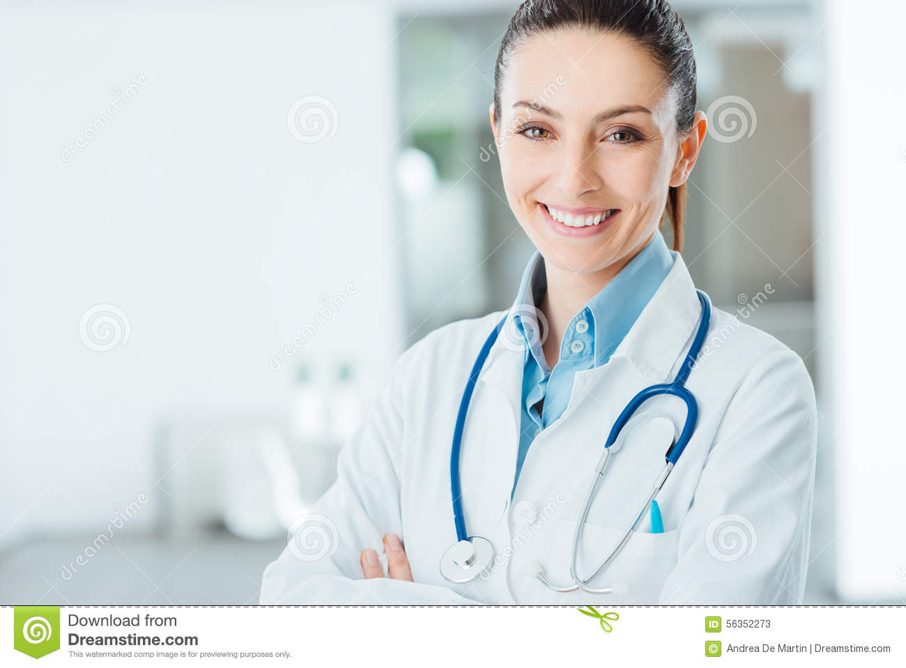 Confident female doctor posing in her office