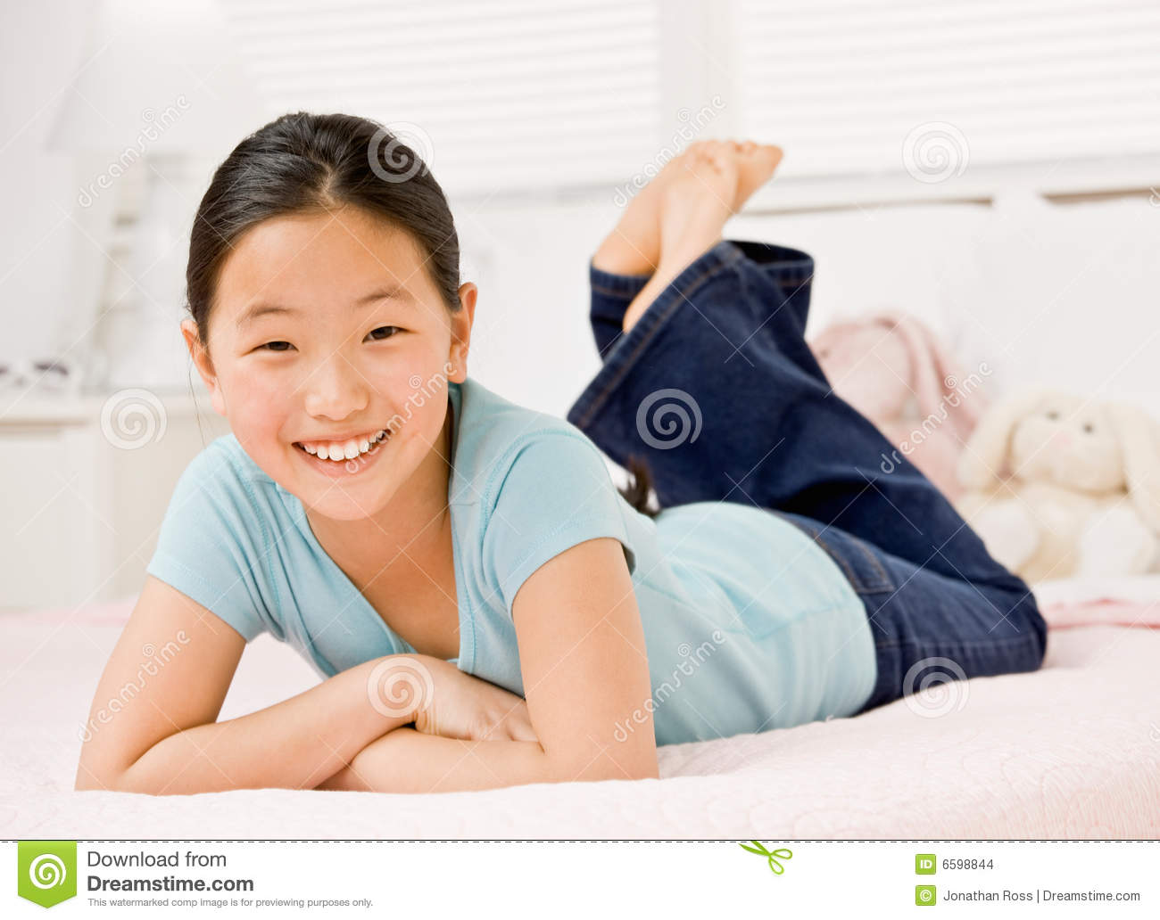 confident girl laying on bed in bedroom stock images image 6598844. Black Bedroom Furniture Sets. Home Design Ideas