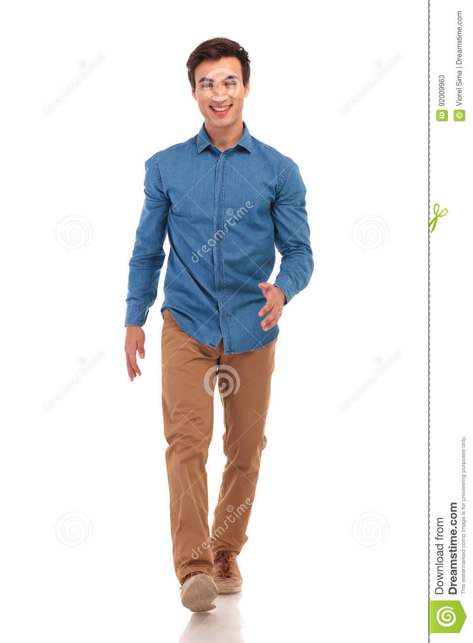 Confident happy young casual man walking forward