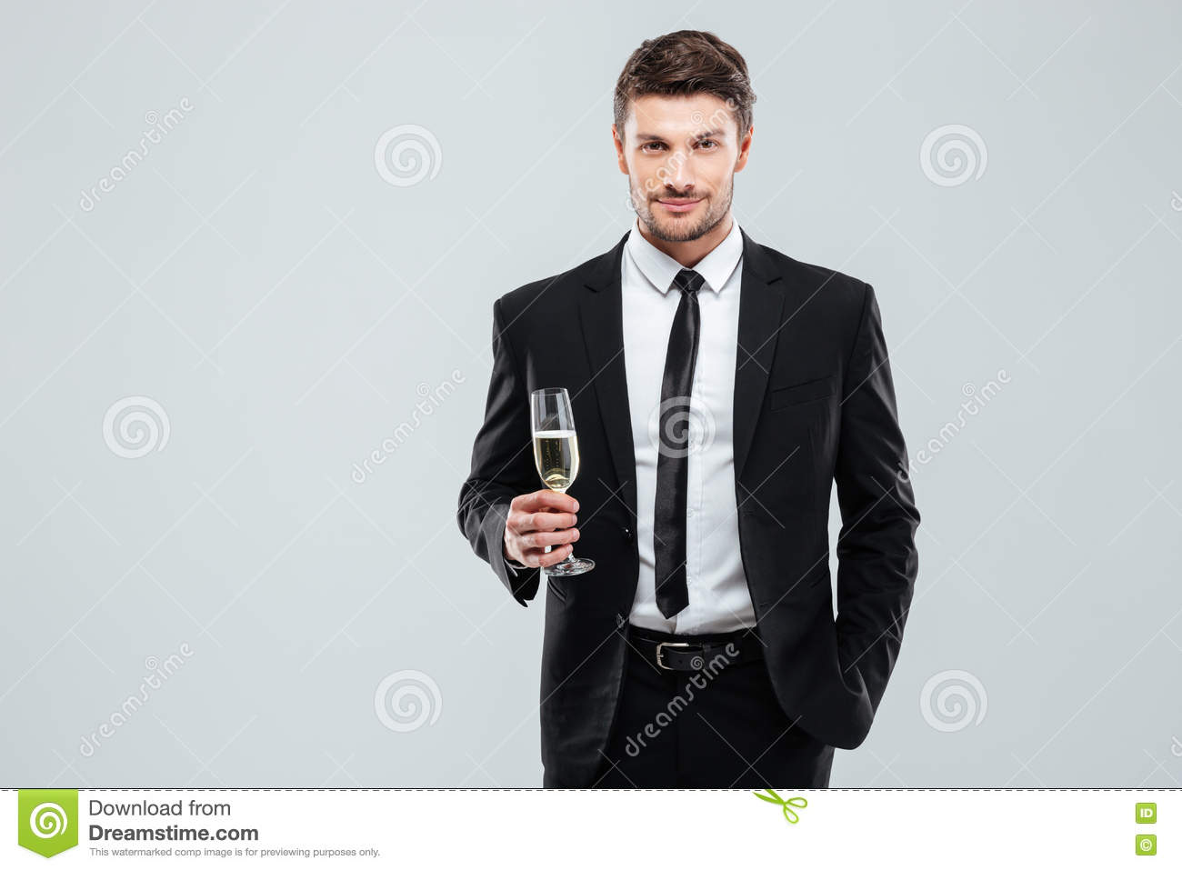 Confident man in suit and tie holding glass of champagne