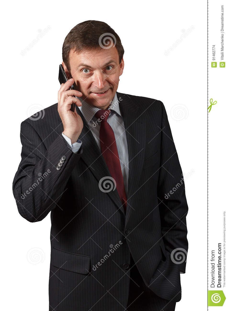 Confident mature businessman speaking on the sell phone on whit
