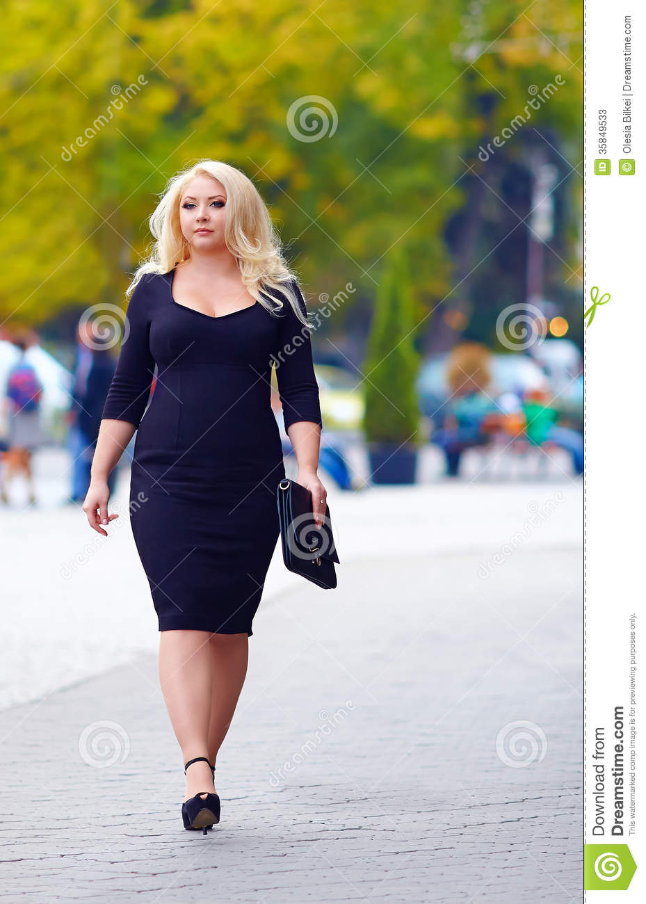 Confident Overweight Woman Walking The City Street Stock