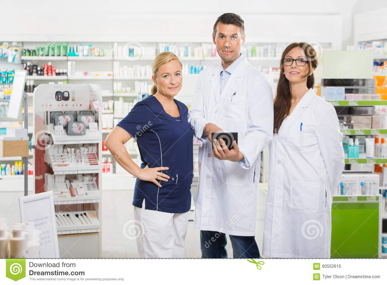 Confident Pharmacists With Digital Tablet Standing