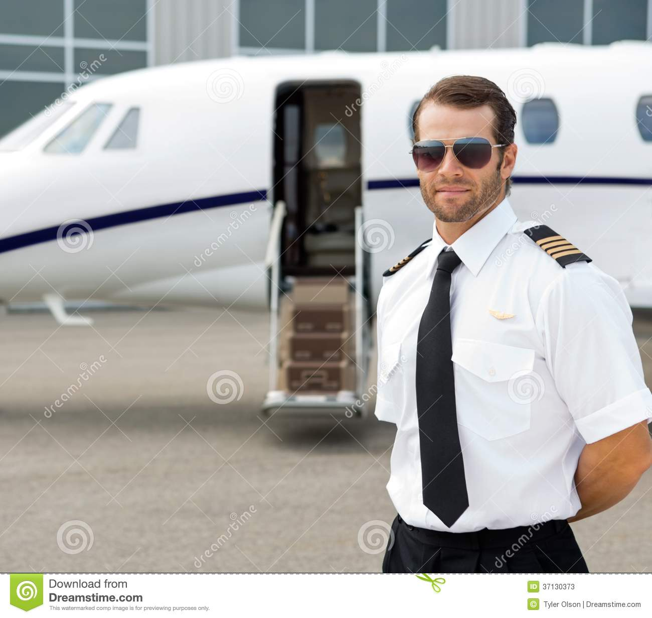 60682377e4 Confident Pilot Wearing Sunglasses Stock Image - Image of handsome ...
