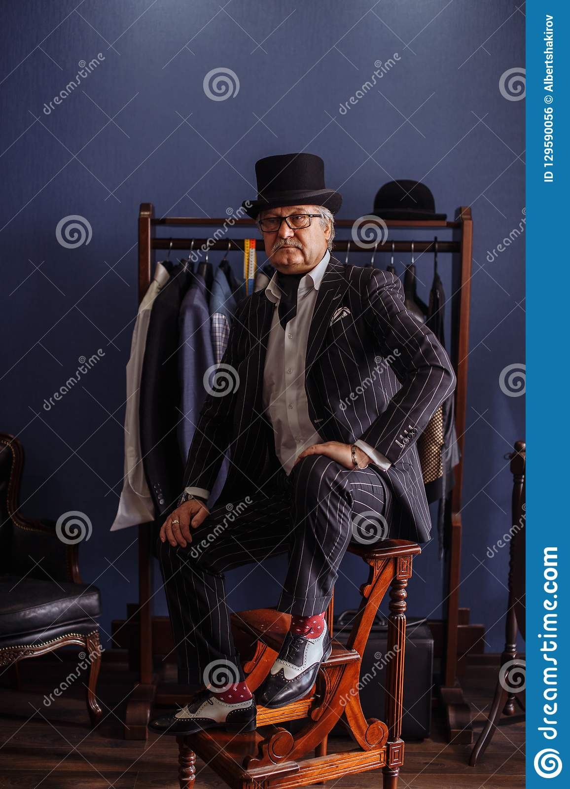 Terrific Confident Retro Style Fashion Man Sitting On Wooden Stool Ocoug Best Dining Table And Chair Ideas Images Ocougorg