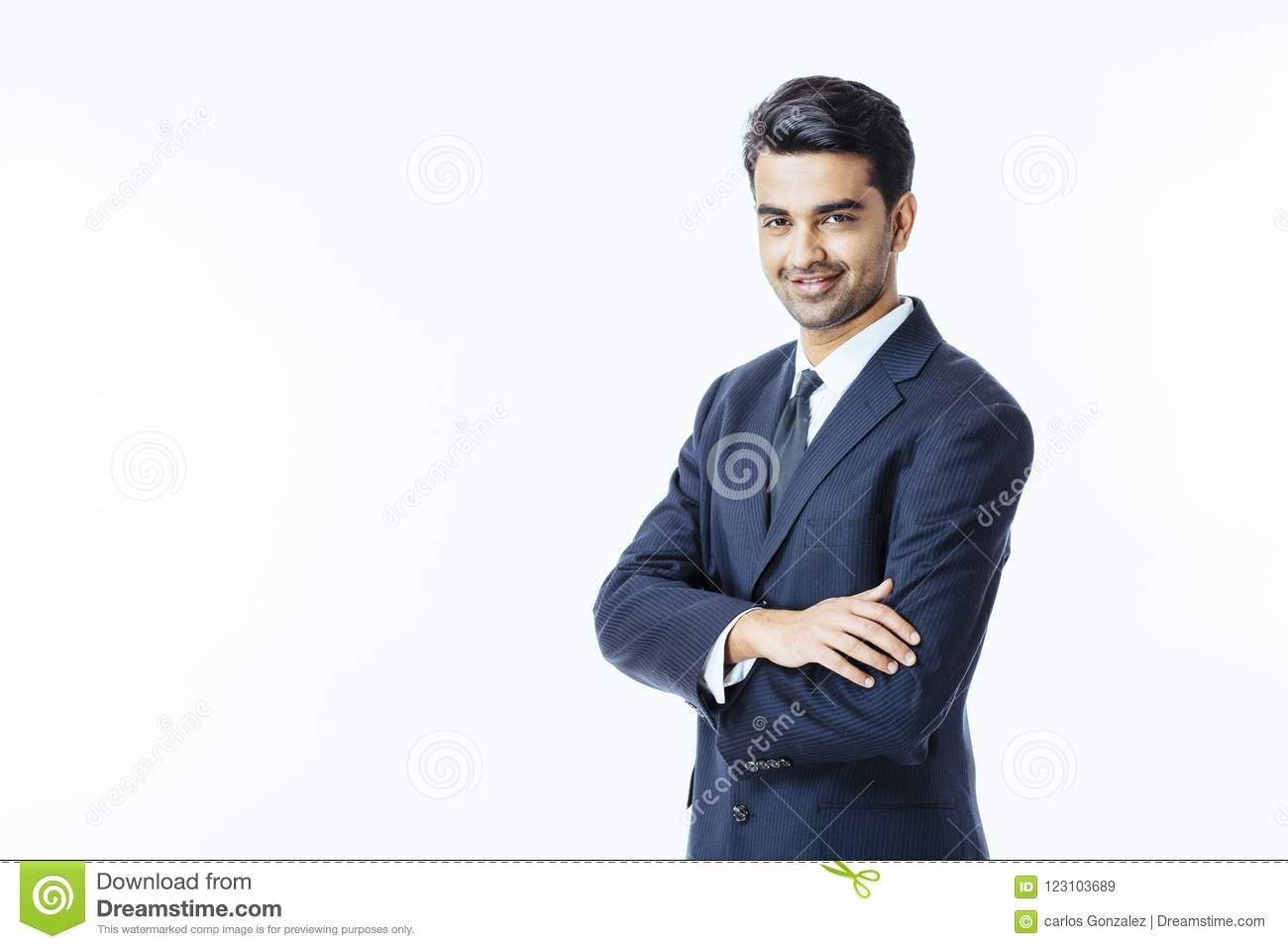Confident smiling businessman with arms crossed