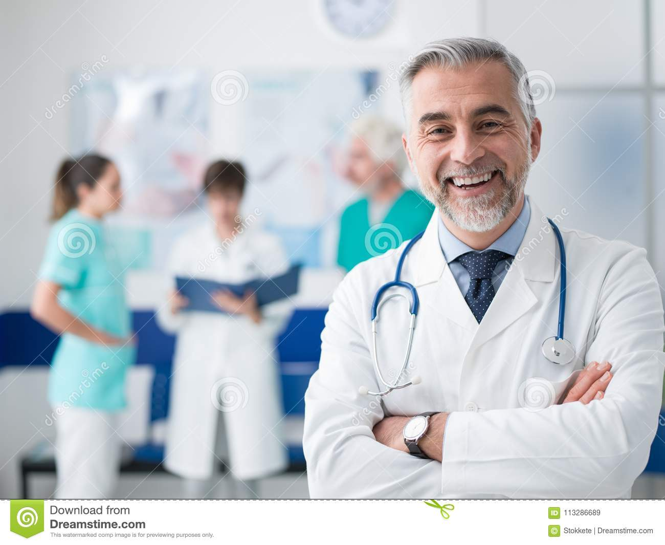 Confident doctor posing at the hospital