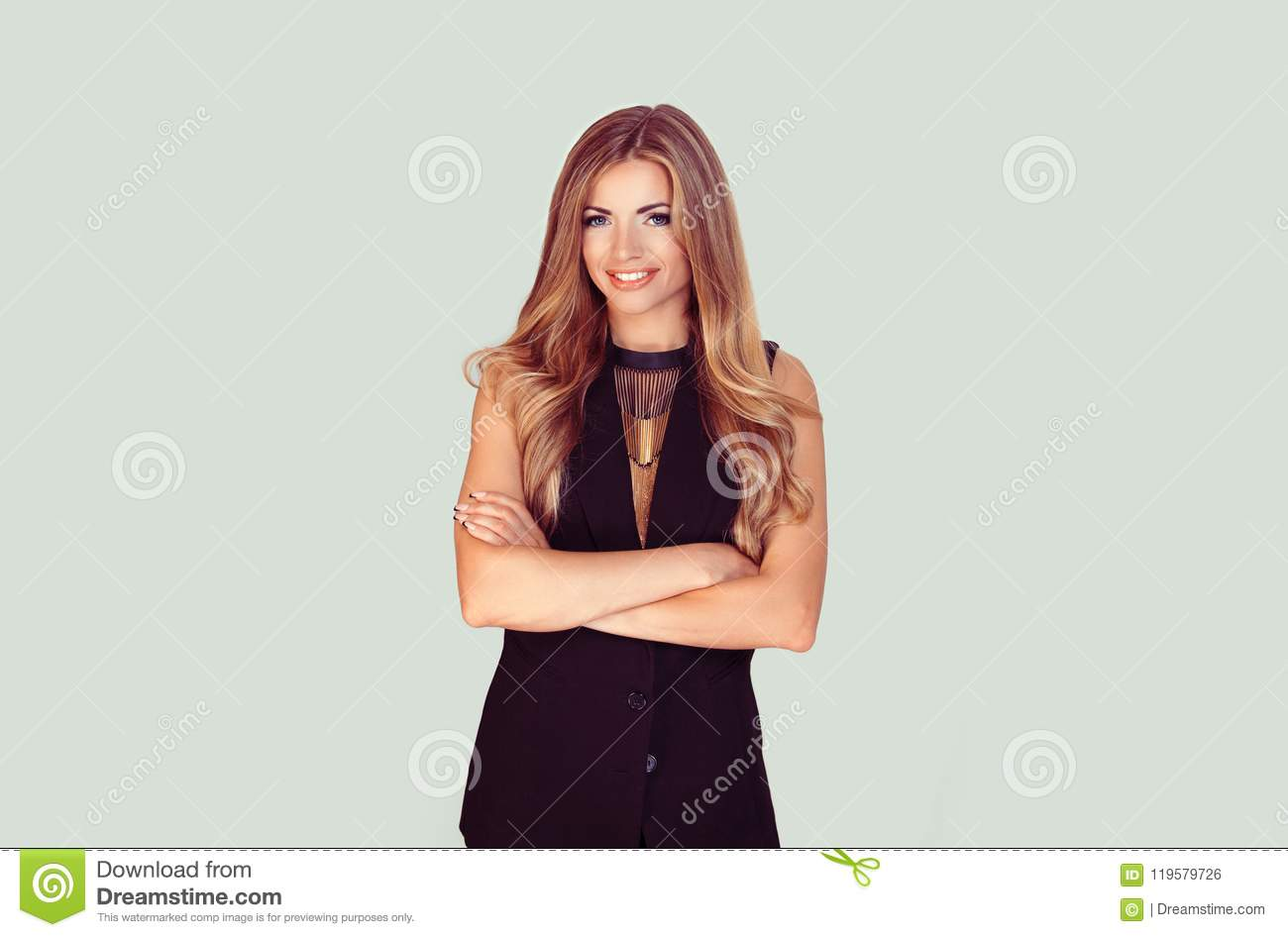 Confident woman with arms crossed isolated light green background