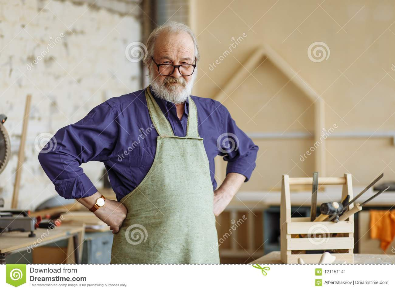 Confident and successful old grey haired man with hands on the hips