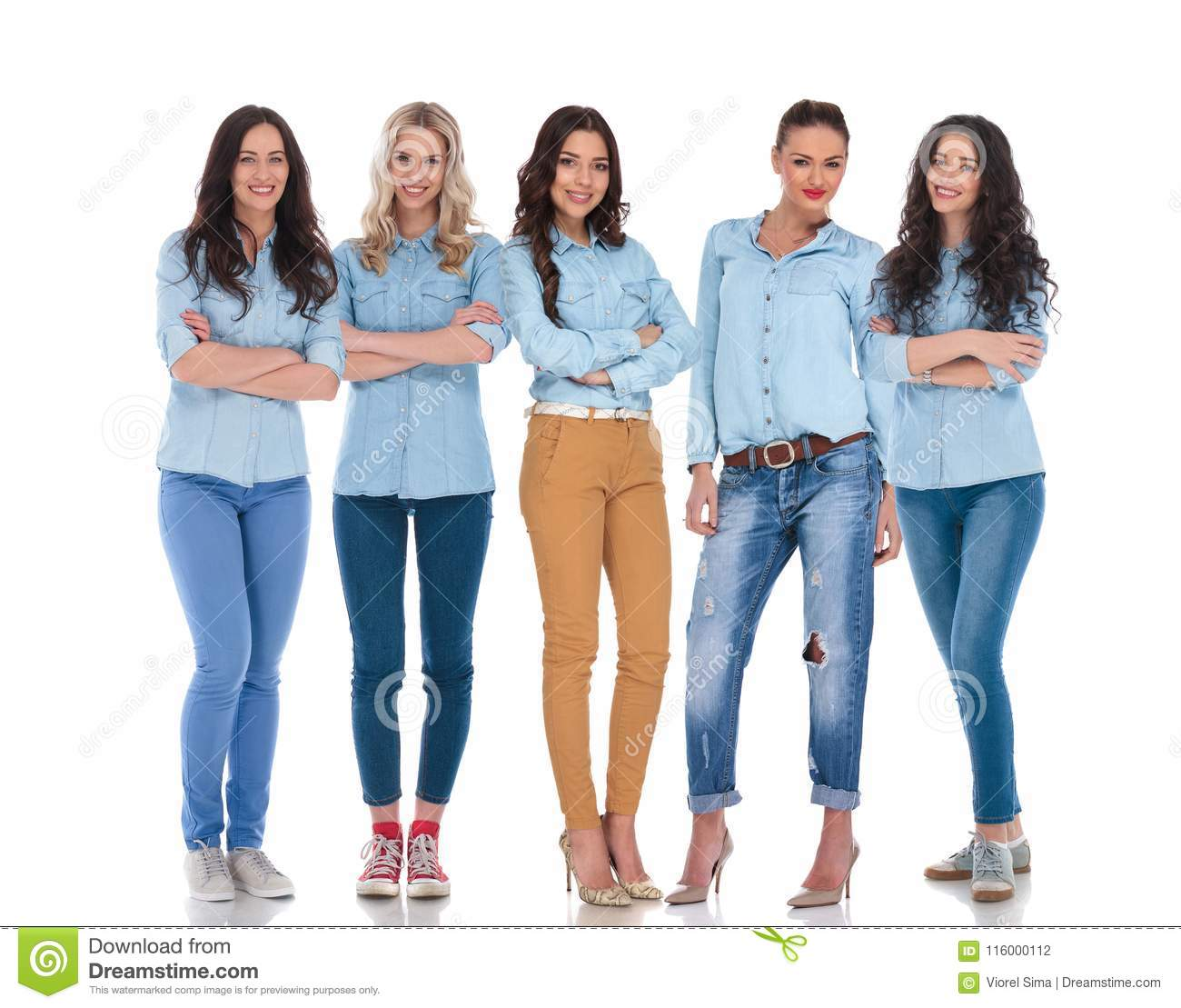 5d147d92370f Confident team of five attractive smart casual women standing on white  background smiling with hands folded