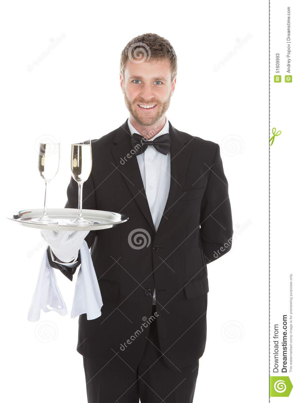 Confident waiter carrying champagne flutes on tray