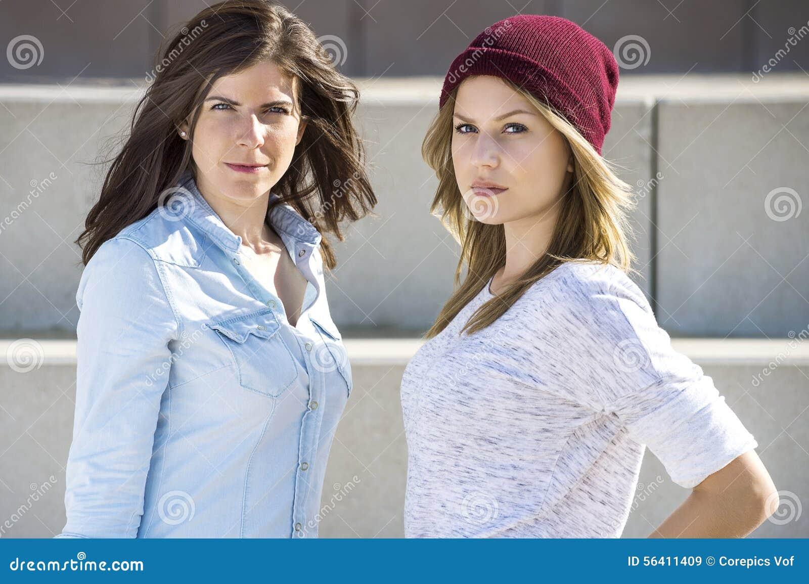 Confident Women Standing At Beach