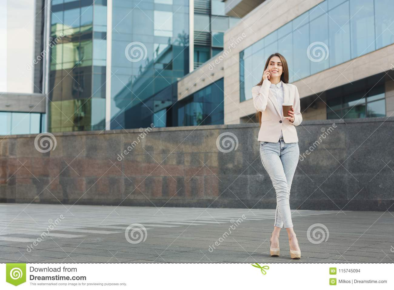 Confident young businesswoman talking on mobile
