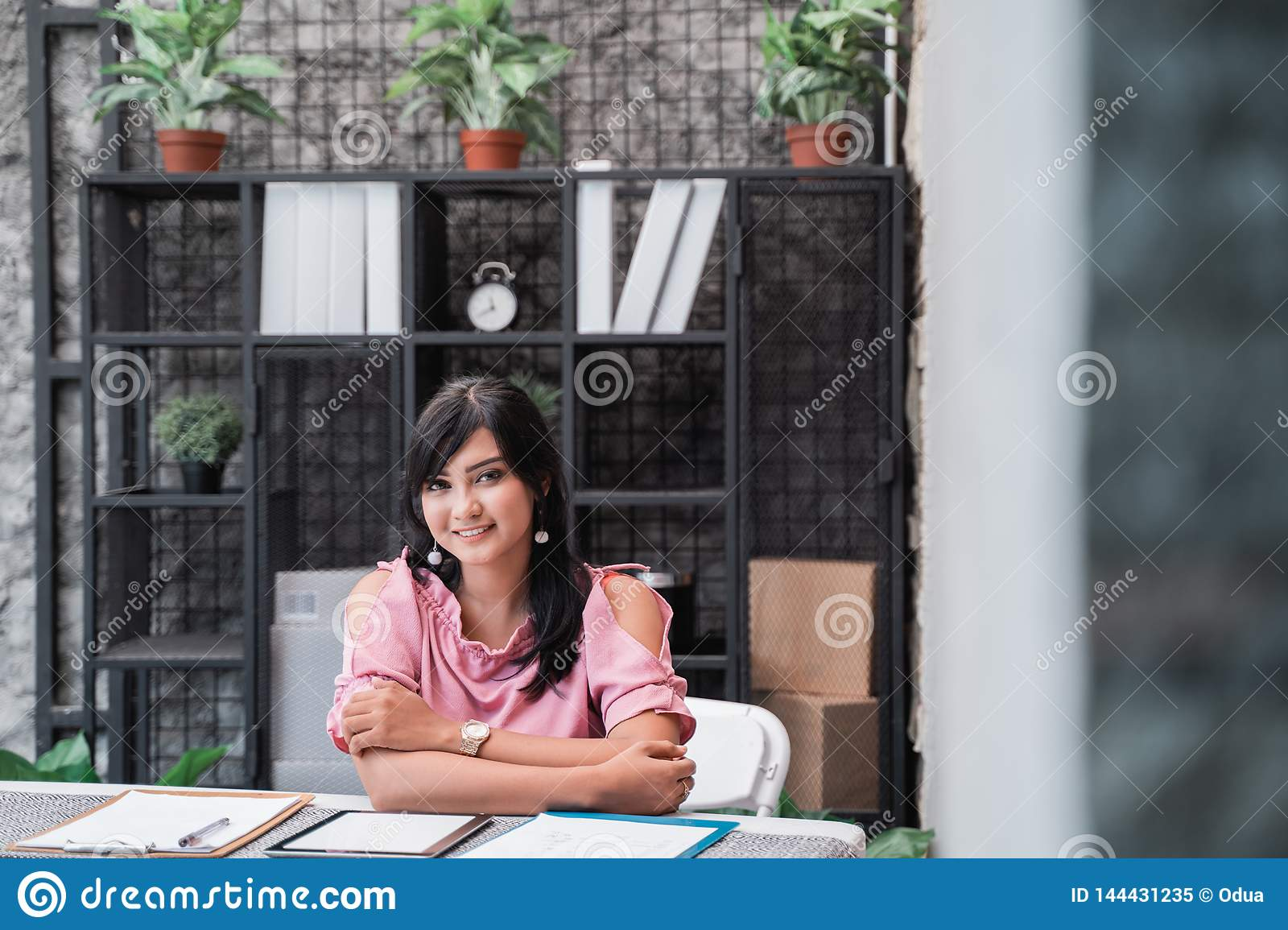 Confident young entrepreneur in her office