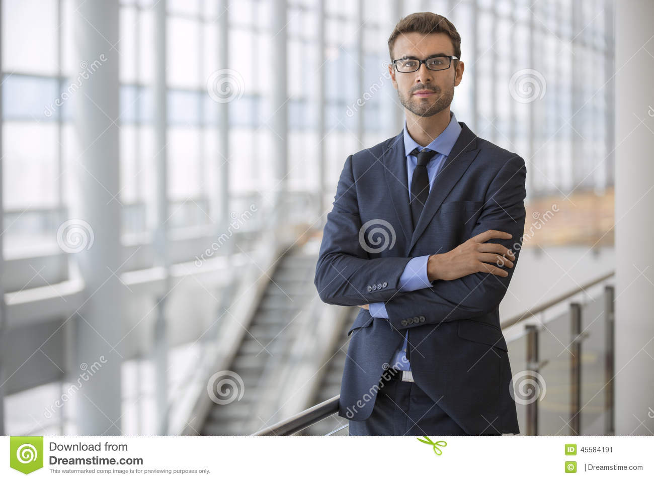 Confident Young Executive Arms Crossed Modern Architecture Escalator Office Building