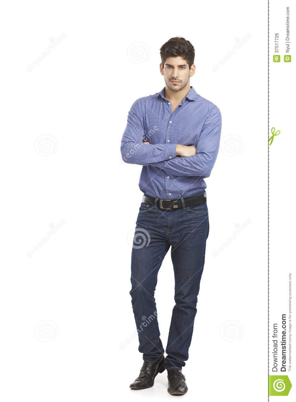 Confident Young Man Standing Arms Crossed Stock Photo ...