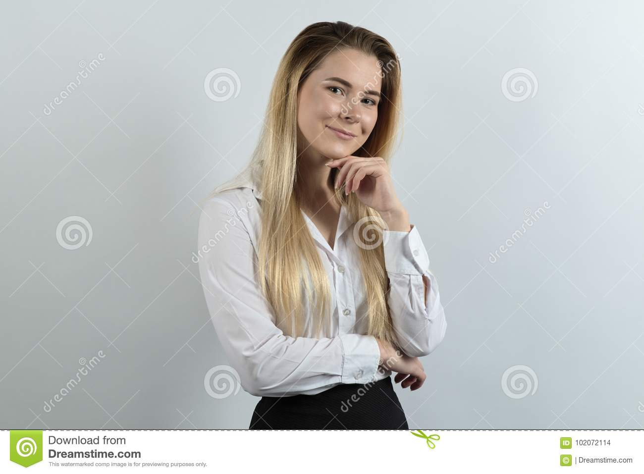 confident young professional woman posing for a portrait in friendly good-natured mood on white background. Long hair, white