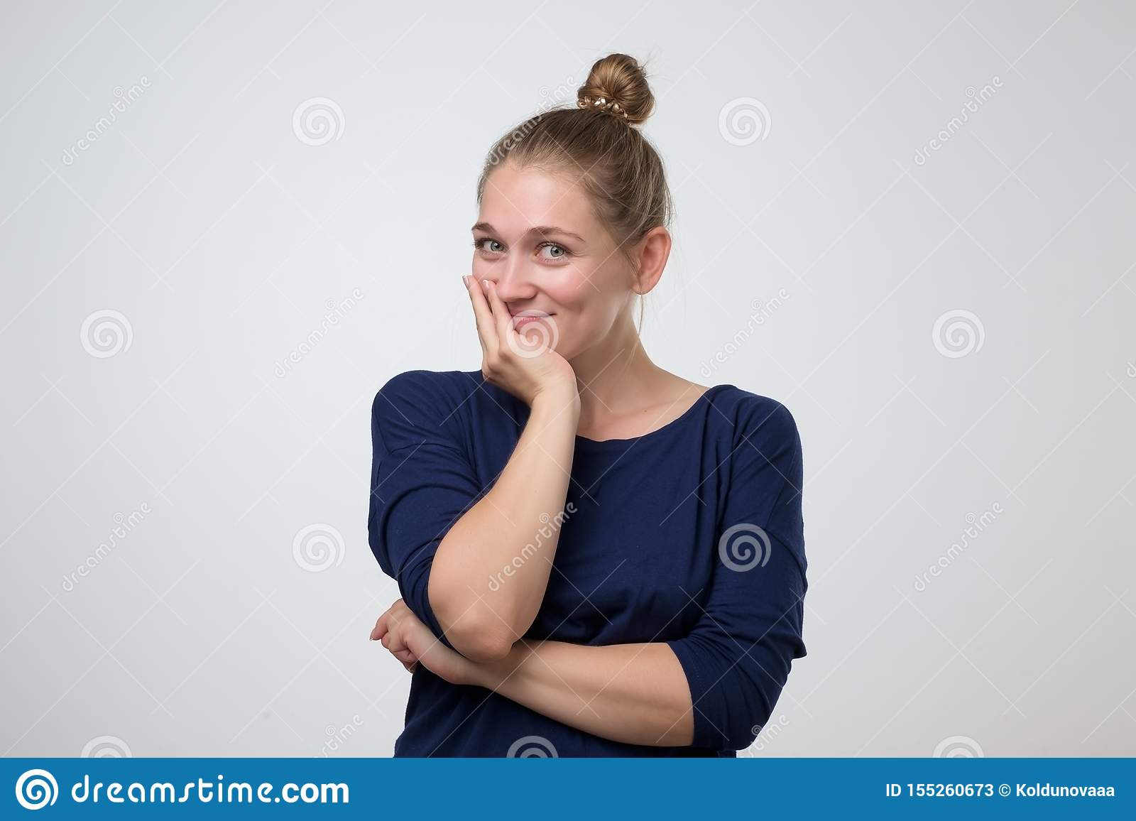Confident young woman with beautiful smile in studio