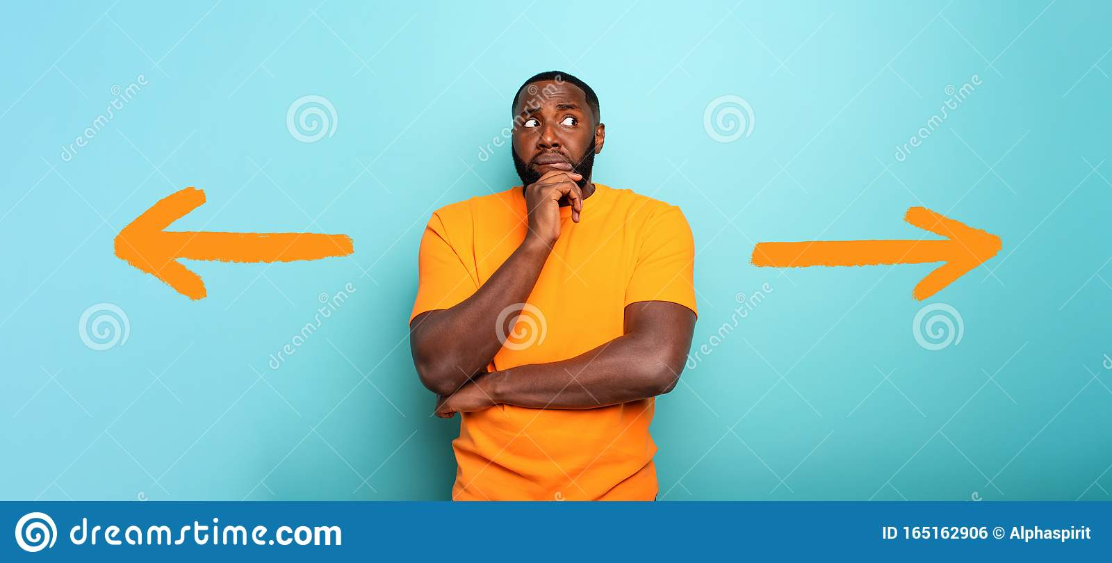 Confuse and pensive expression of a boy with right or left to choose. cyan colored background