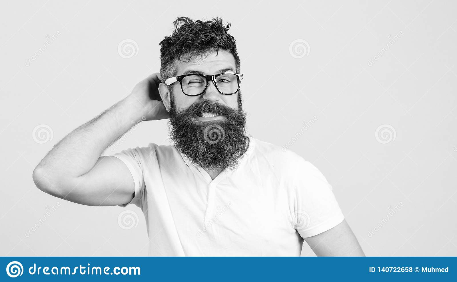 Confused bearded young man in glasses. Hipster trying to solve difficult problem. Bearded guy tries to gather with thoughts.