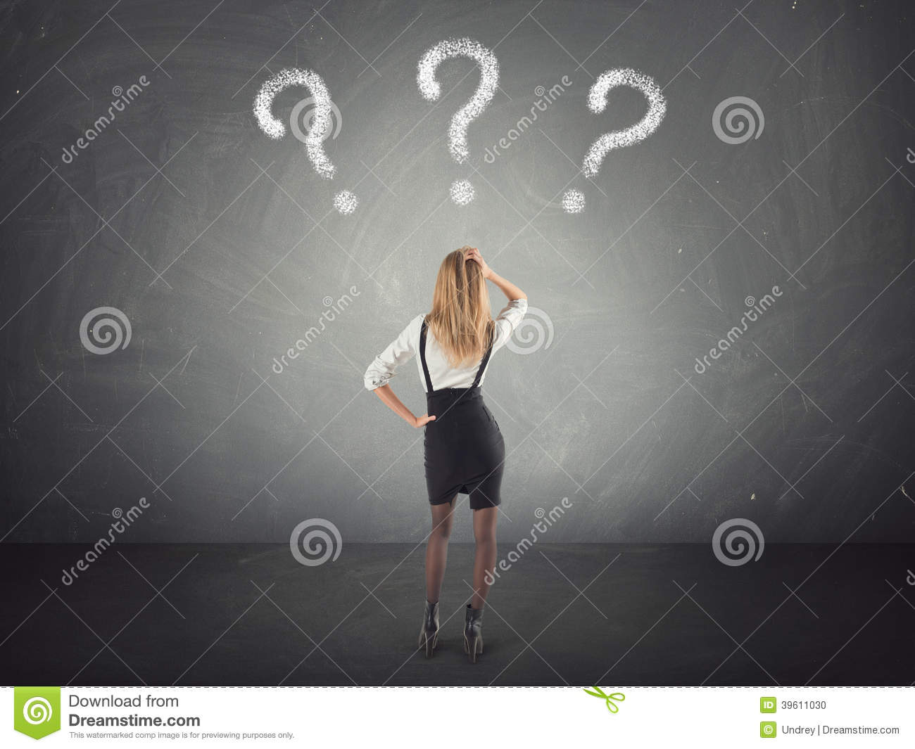 Confused businesswoman thinking, looking at questions mark in the wall