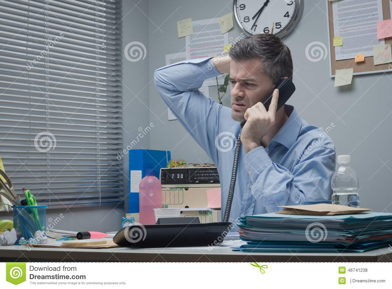 confused employee on the phone stock photo